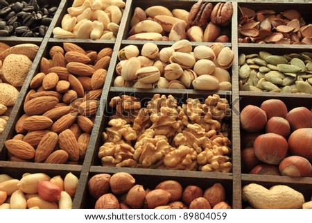Types of nuts: peanuts, hazelnuts, chestnuts, walnuts, cashews, pistachio and pecans. Food and cuisine.