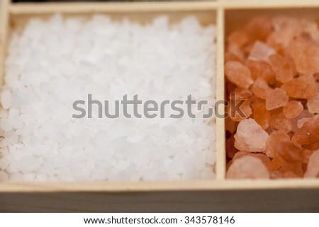 Types of salt: sea salt and himalayan salt with macro details - stock photo