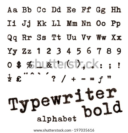 Typewriter bold alphabet. Macro photograph of typewriter letters isolated on white. - stock photo