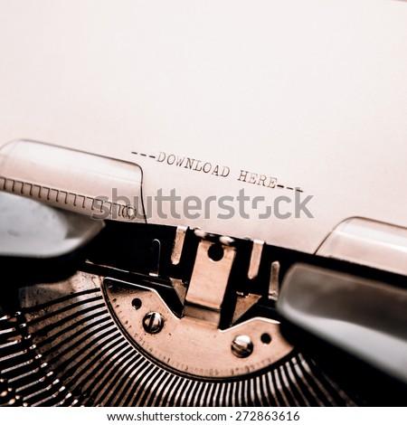 Typewriter closeup shot, concept of download - stock photo