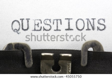 Typewriter closeup shot, concept of Questions - stock photo