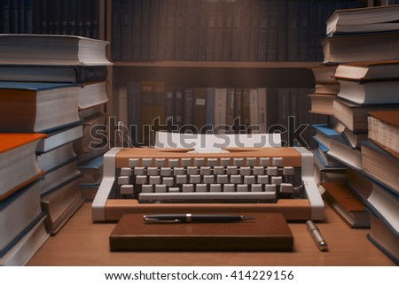 Typewriter with blank sheet of paper with many books in background and  beside- film effect - stock photo
