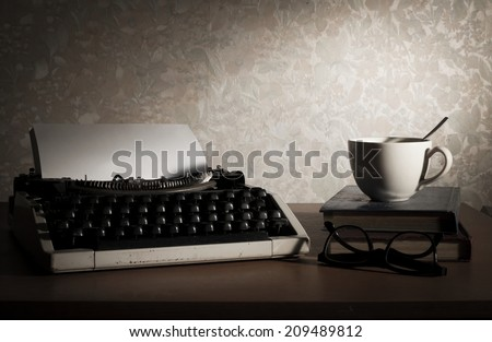 Typewriter with coffee cup,book and eyeglasses,vintage filtered image.   - stock photo