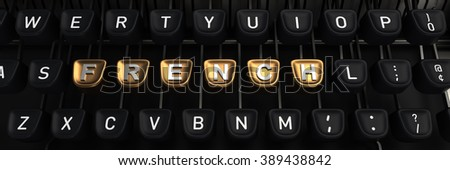 Typewriter with FRENCH gold buttons - stock photo
