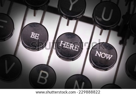 Typewriter with special buttons, be here now - stock photo