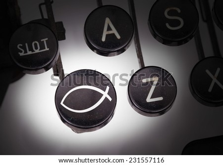Typewriter with special buttons, Christian fish symbol - stock photo