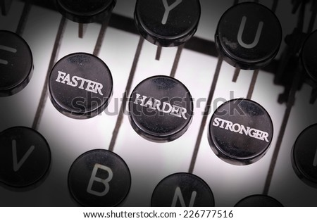 Typewriter with special buttons, faster harder stronger - stock photo