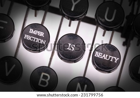 Typewriter with special buttons, imperfection is beauty - stock photo