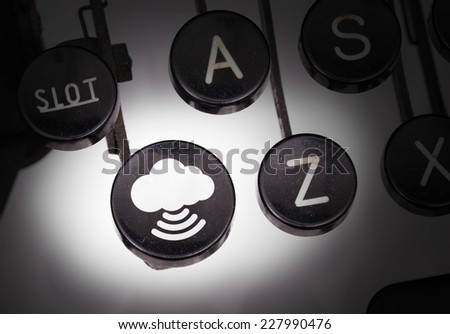 Typewriter with special buttons, migrate to cloud - stock photo