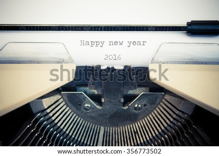 typewriter with white paper. Happy new year 2016 sign - stock photo