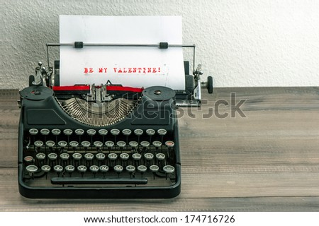 typewriter with white paper page on wooden table. sample text Be My Valentine! - stock photo