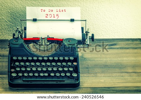 Typewriter with white paper page on wooden table. sample text  To Do List 2015. vintage instagram style toned picture - stock photo