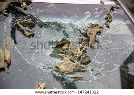 Typhoon damaged car windows - stock photo