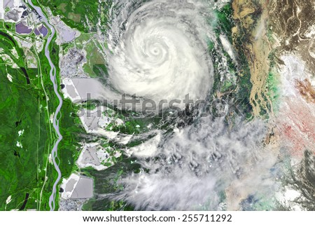 Typhoon near crop field leaving floods and waste land - stock photo
