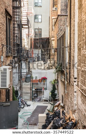 Typical alley between buildings in New York City - stock photo