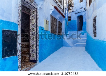 Typical alley in the blue medina of Chefchaouen, Morocco. - stock photo