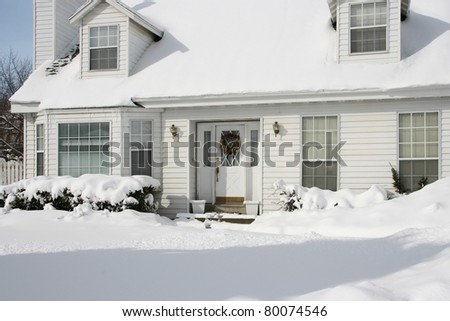Typical American home in winter - new snow - cape cod style - stock photo