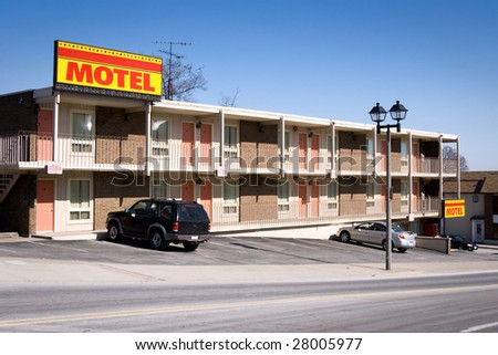 Typical american inexpensive motel with parking and separate rooms. Shot in Niagara Falls, Ontario, Canada. - stock photo