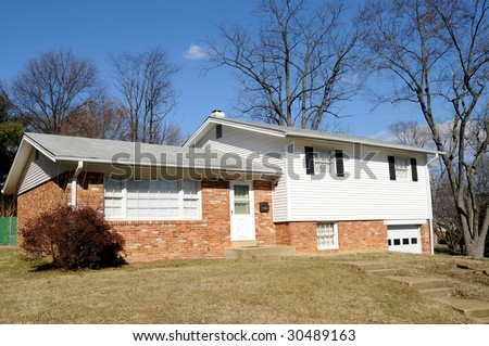 Typical American split-level home built in the 1960's. - stock photo