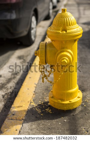 Typical american yellow fire hydrant in San Juan, Puerto Rico. - stock photo
