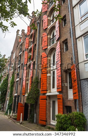 Typical Amsterdam brick stone house in suburb - stock photo