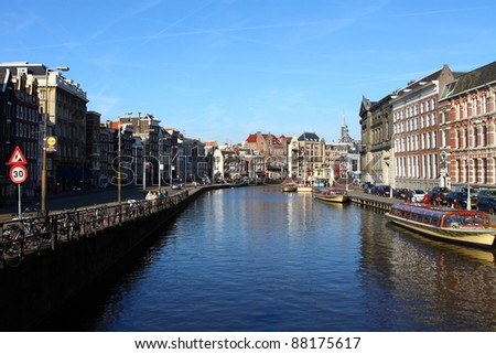 Typical Amsterdam houses over blue sky - stock photo