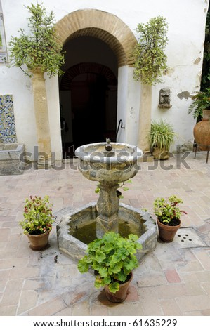 "Typical Andalusian patio with plants and a fountain inside the so-called ""Palacio de Viana"" in Cordoba, Spain - stock photo"