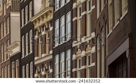 Typical architecture of dutch buildings front in Amsterdam  - stock photo