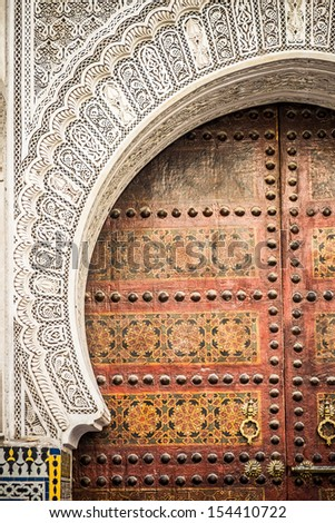 Typical architecture of moroccan door in Marrakech - stock photo