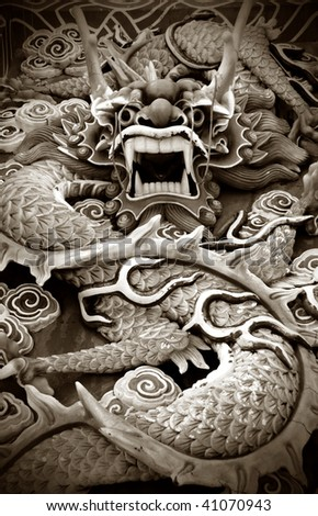 Typical auspicious dragon status in chinese temple that brings good luck. - stock photo