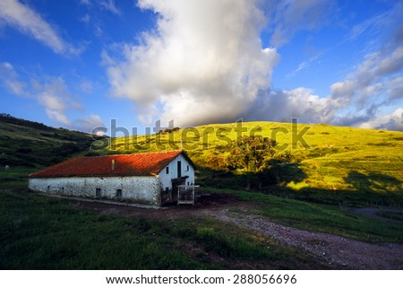 typical basque country architecture in Gorliz on sunny day - stock photo