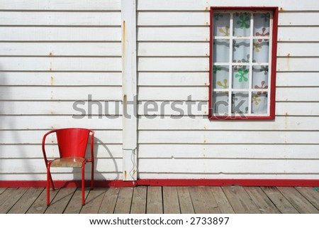 Typical beach house with red details - stock photo