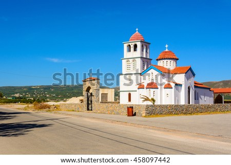 Typical beautiful Greek white church at Kissamos harbor, Crete.  District of Chania. Greece. - stock photo