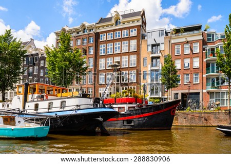 Typical bend houses in AMsterdam, Netherlands - stock photo