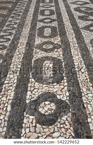 "Typical black and white, Portuguese ""calcada"" mosaic cobblestone paving. Elvas, Alentejo region, Portugal. Also found in Brazil and other countries which were Portuguese colonies."