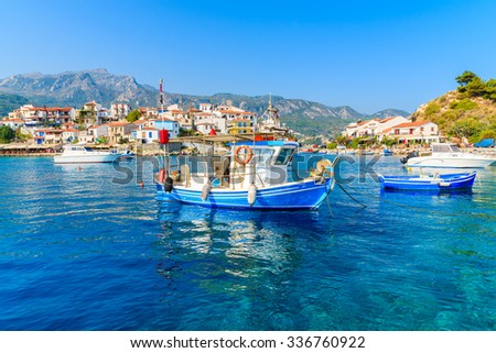 Typical blue and white colour fishing boat in Kokkari port, Samos island, Greece - stock photo