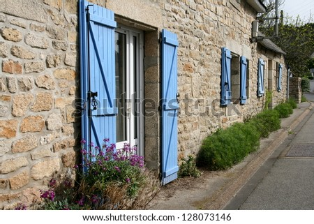 Typical Brittany house with blue shutters, France - stock photo