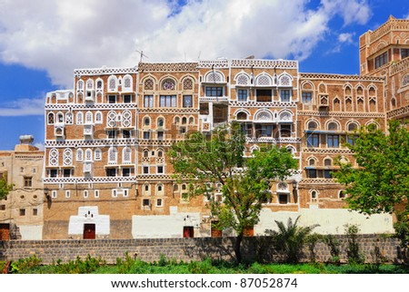 Typical building from mud bricks in the capital of Yemen, Sanaa - stock photo