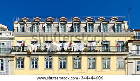 Typical building the center of Lisbon, Portugal, with the underwear hanging to dry on the sun - stock photo