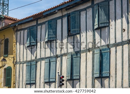 Typical buildings of Basque country in a street of Bayonne. Aquitaine, France.