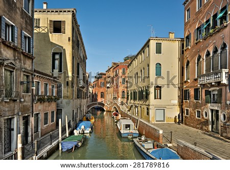 typical canal with old colorful brick houses and boeats in Venice, Italy, Europe - stock photo