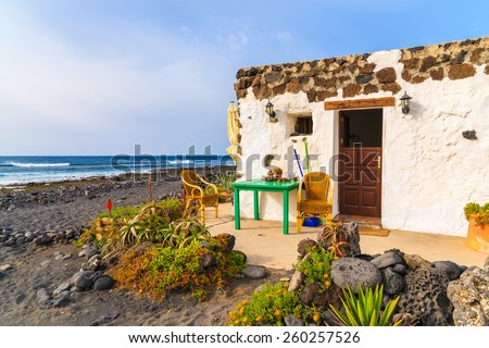 Typical Canarian house for tourists on El Golfo beach, Lanzarote island, Spain - stock photo
