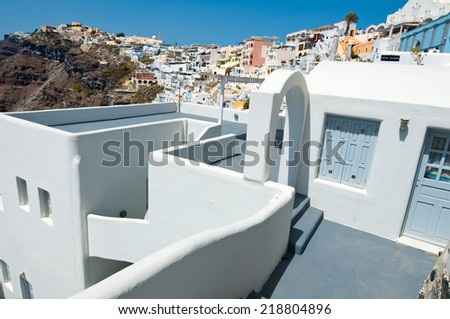 Typical caved house with patio in Fira town on the Santorini (Thira) island in Greece. - stock photo