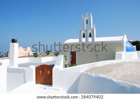 Typical Church with bell tower (Santorini Island - Greece) - stock photo