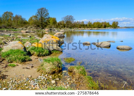 Typical coastline in the southern Swedish archipelago of Blekinge, with granite boulders, juniper and forests mixed in grassland. - stock photo