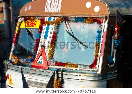 Typical, colorful, decorated public transportation bus in Jaipur, India
