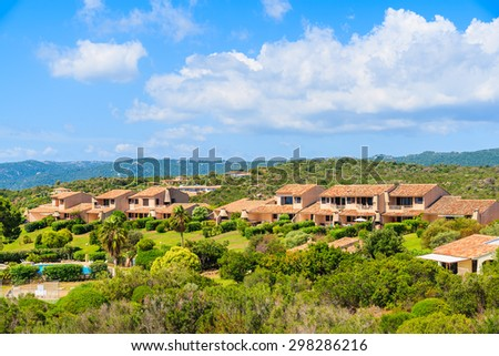 Typical Corsican villa houses on green hill in rural landscape of Corsica island, France - stock photo