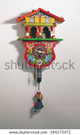 Typical cuckoo clock over a white wall - stock photo