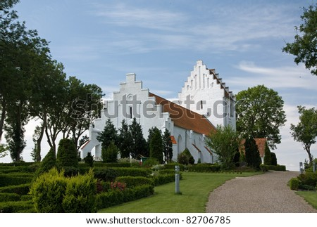 Typical Danish white church on Funen - stock photo