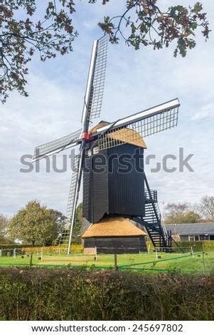 Typical Dutch Doesburger mill in Gelderland Holland - stock photo